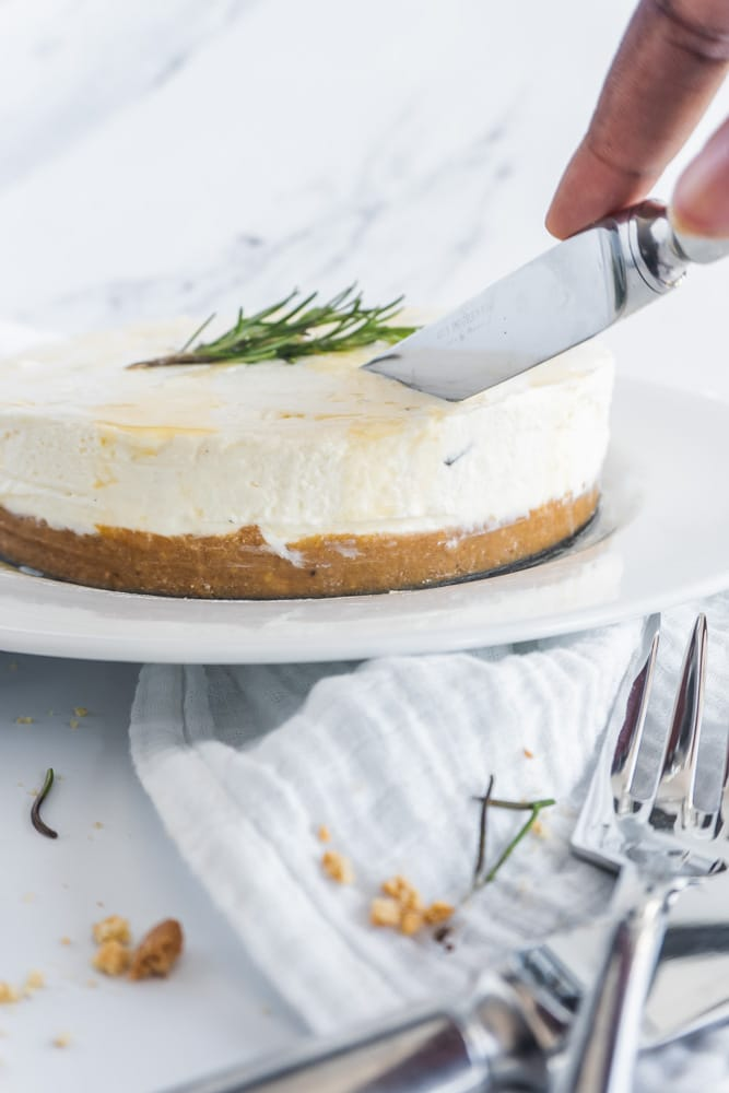 cutting into the cheesecake
